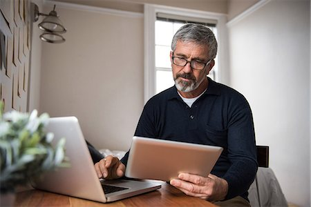 Older man working on computer